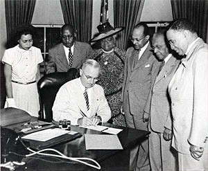 President Harry Truman signing legislation establishing February 1 as National Freedom Day, June 30, 1948